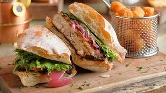 The Jerk chicken sandwich is made with grilled