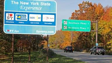 The controversial blue New York State tourism signs