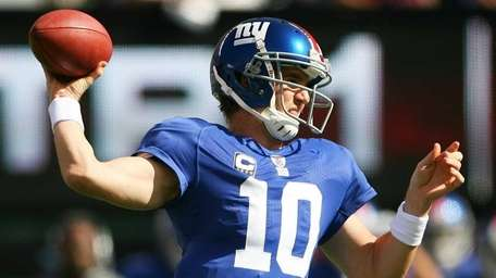 The Giants' Eli Manning drops back to pass