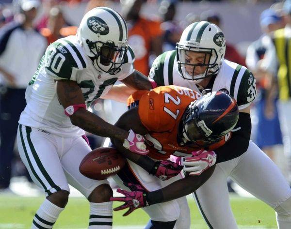 Denver Broncos running back Knowshon Moreno (27) fumbles