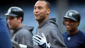 Yankees captain Derek Jeter smiles as Robinson Cano