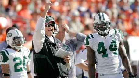 Jets head coach Rex Ryan celebrates a penalty