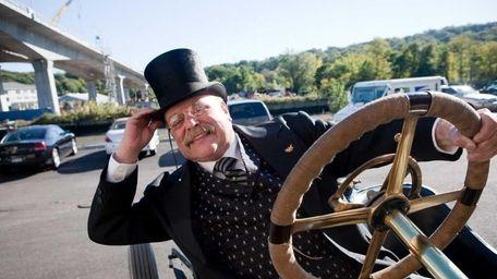 James W. Foote, dressed as Theodore Roosevelt, steers