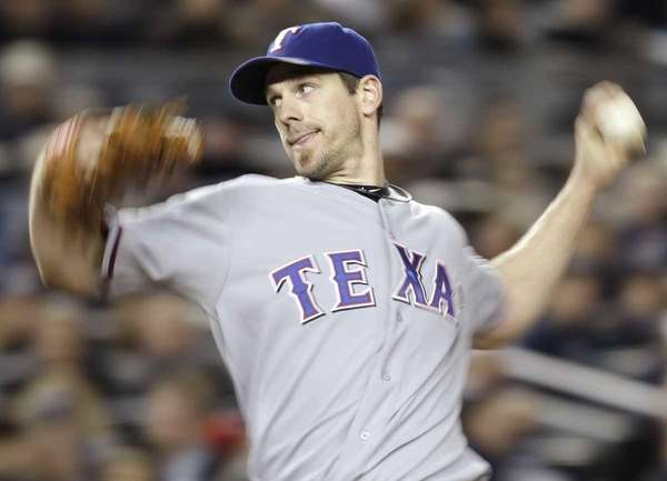 Texas Rangers' Cliff Lee pitches against the New