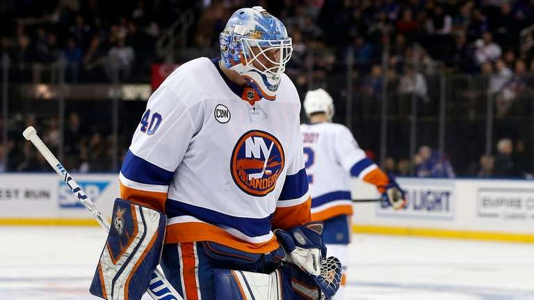 The Islanders' Robin Lehner looks on during a