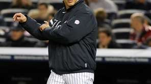 Yankees manager Joe Girardi signals for a pitching