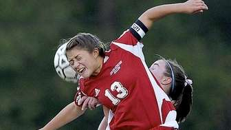 Center Moriches' Alexis Parlato goes up for a