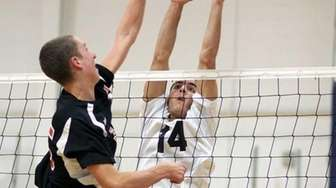 Plainview's Greg Rankel sets for the block in