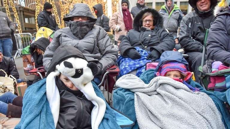 People are bundled up in many different ways,