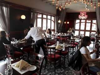 Customers lunch at Aperitif, a French bistro in