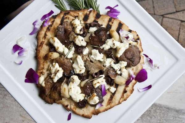 Courtney's Pizza, made with goat cheese, olives, roasted