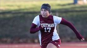 Suffolk's Joie Tortorice of Whitman goes after the