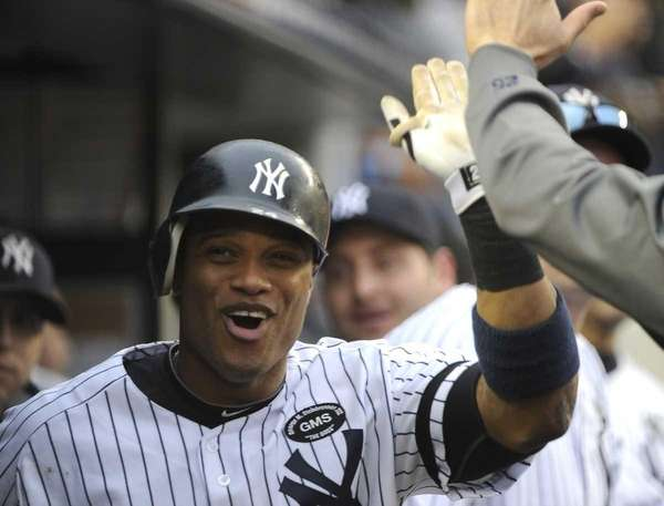 Robinson Cano celebrates in the dugout after his