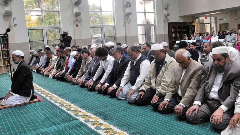 Muslim men pray at afternoon services in the