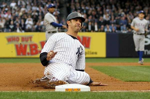 Jorge Posada is safe at third base on
