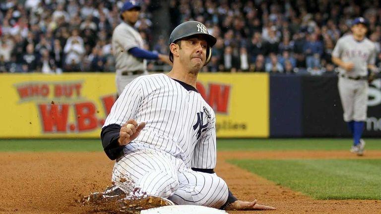 Jorge Posada is safe at third base on