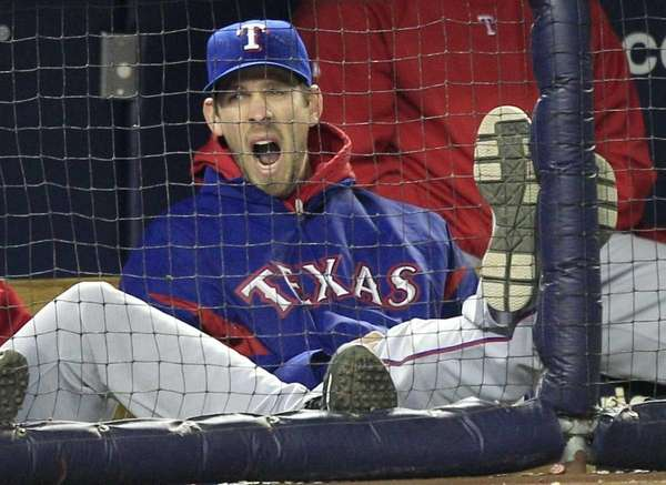 Texas Rangers pitcher Cliff Lee yawns as he