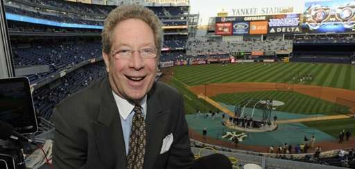 John Sterling sits in his booth before a