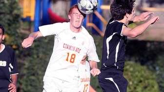 Chaminade's Daniel Kelly heads the ball in a