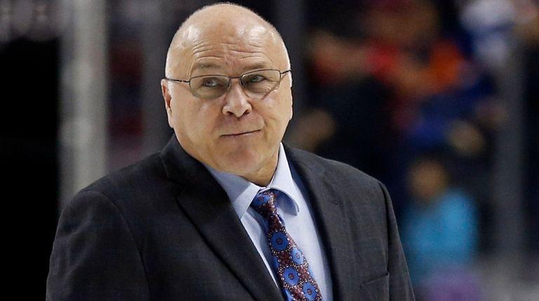 Islanders coach Barry Trotz walks off the ice