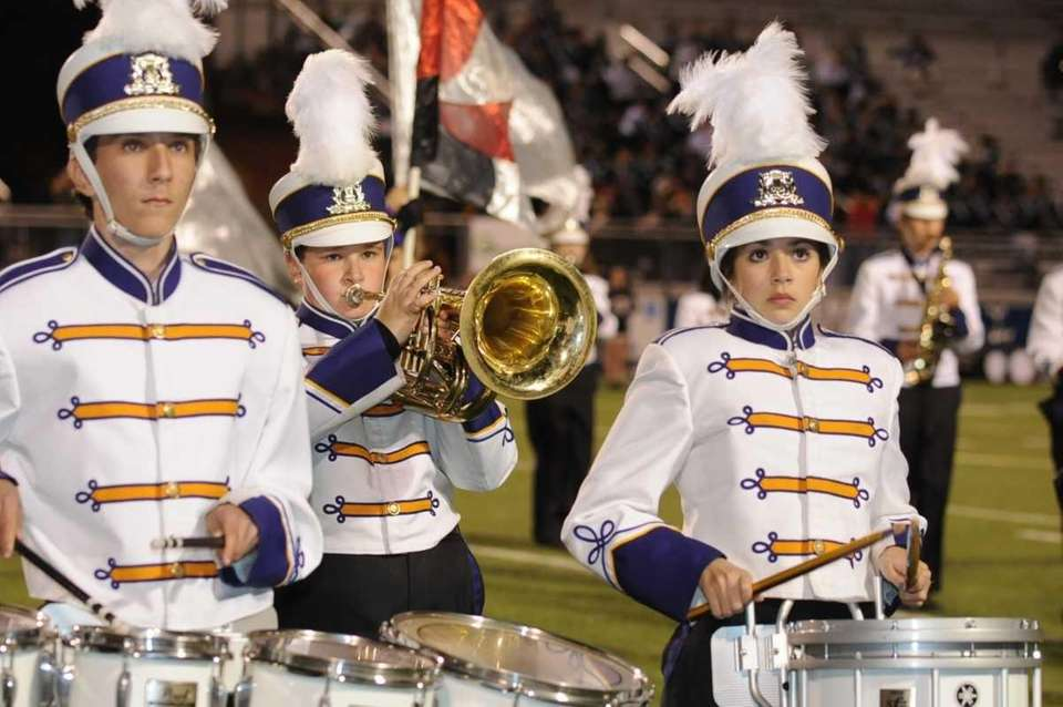 The Islip High School marching band performs at