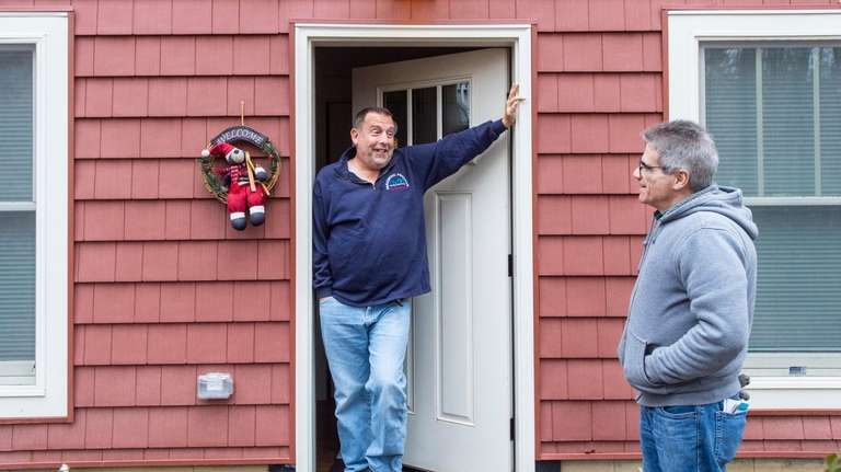 Homeowner Vince Taldone, right, at the entrance to