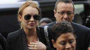 Lindsay Lohan, left, arrives for a probation violation