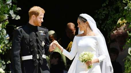 Britain's Prince Harry and Meghan Markle stand on