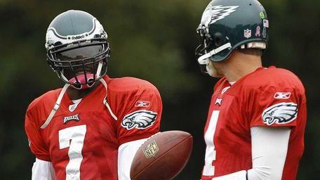 Philadelphia Eagles quarterbacks Michael Vick, left, and Kevin