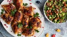 Pomegranate glazed chicken and chopped Israeli salad.