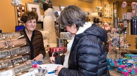 Marilyn Schulman, co-owner of Willy Nilly Trading, assists