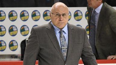 Islanders head coach Barry Trotz walks off the