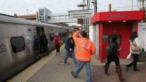An MTA passenger service worker directs LIRR riders