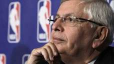 National Basketball Association commissioner David Stern listens to