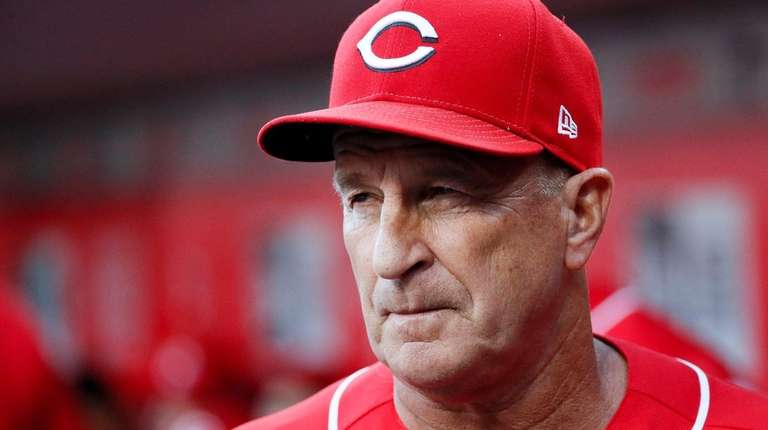Then-Reds interim manager Jim Riggleman looks on in
