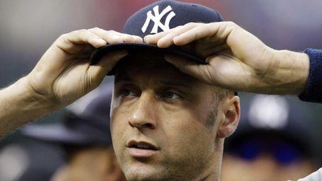 New York Yankees' Derek Jeter adjusts his cap