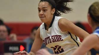 Olivia Medford #22 of South Side dribbles downcourt