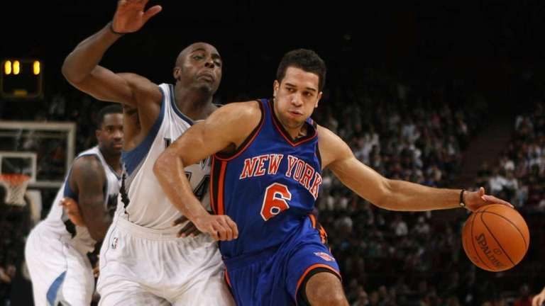 Anthony Tolliver, left, and Landry Fields, fight for