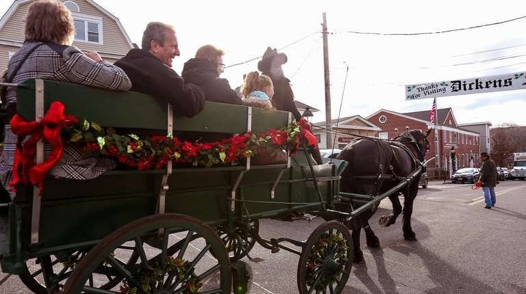Visitors take horse and buggy rides during the