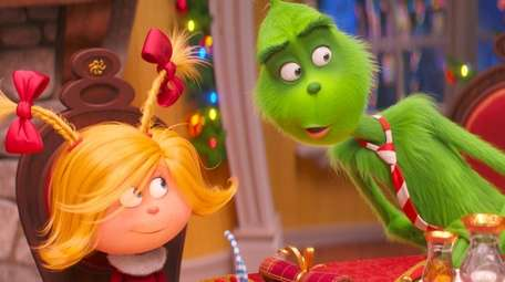 Cindy-Lou Who (Cameron Seely) helps liberate the Grinch