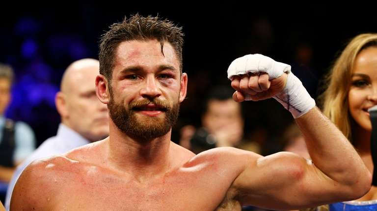 Chris Algieri celebrates defeating Erick Bone of Ecuador