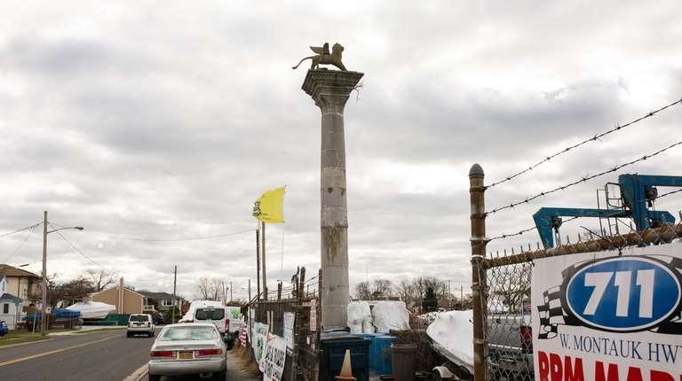 A column topped with a statue of a