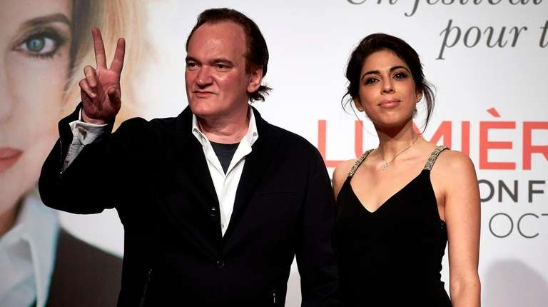 Quentin Tarantino  poses with  Daniella