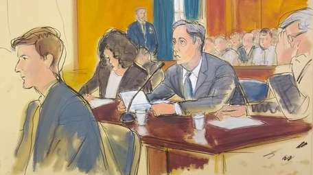 Michael Cohen is seen reading from a statement