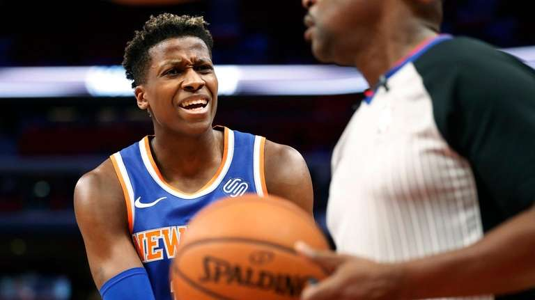 Knicks guard Frank Ntilikina argues a call with