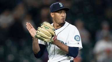 Relief pitcher Edwin Diaz of the Mariners celebrates