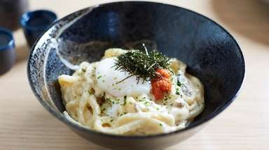 Creamy mentai udon is punched up with cod