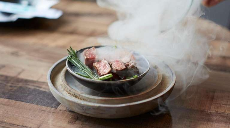 Misty beef arrives as a smoke-filled dome that's