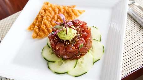 Yellowfin tuna tartare is served with a sesame