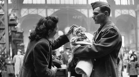 A soldier says goodbye to his wife and